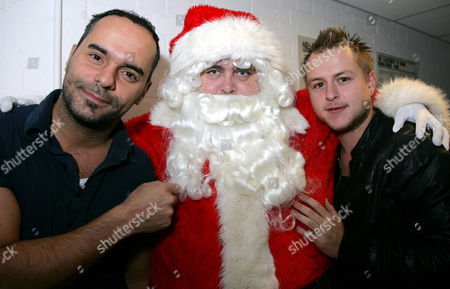 Michael Greco and Lee Otway who are in Aladdin at the Lighthouse Theatre Poole, meet Santa prior to the Xmas lights switch on at the Dolphin Centre, Poole