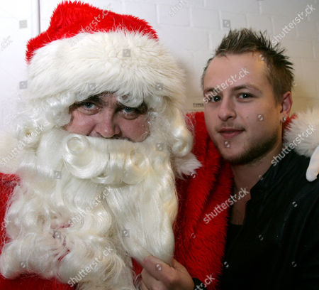Lee Otway who is in Aladdin at the Lighthouse Theatre Poole, meets Santa prior to the Xmas lights switch on at the Dolphin Centre, Poole