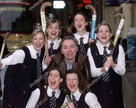 ANDREW LLOYD WEBBER Composer and impressario Andrew Lloyd Webber is surrounded by the cast of his new production called Daisy Pulls It Off in London . They are from left, back row, Katherine Igoe, Hannah Yelland, Katherine Heath, Emma Stansfield, and front row from left, Jane Mark, Anna Francolini. The show starts its run in April 2002