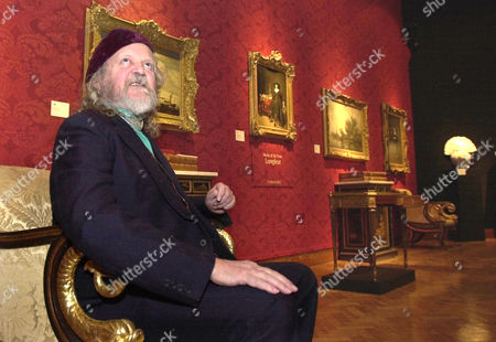The Marquess of Bath sits amongst works of art from Longleat House as he posses for photographers following a press conference held at Christies auctioneers in London . He announced plans for the sale of paintings, furniture, silver and porcelain, books and manuscripts, from the Marquess of Bath's family home Longleat House in Wiltshire, on June 13-14, 2002. The Marquess of Bath and his Trustees have instructed Christies to raise in excess of 15 million pounds, ($ 21 million) to secure the long-term preservation of Longleat House