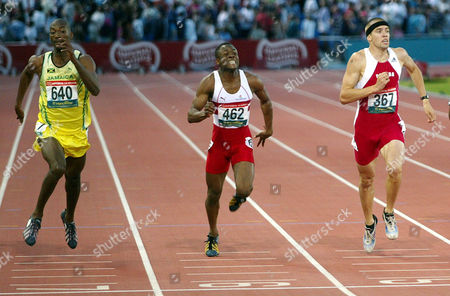 Jamaica's Michael Blackwood, left, closes in on the finish line on his way to winning the gold medal in the Men's 400 meters at the Commonwealth Games in Manchester, England . Canada's Shane Niemi, left, took the silver and England's Daniel Caines, center, finished in 4th place