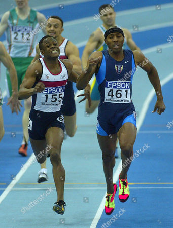 Tyree Washington of the United States, right, races along side Britain's Daniel Caines on his way to winning the gold medal in the Men's 400 meters at the World Indoor Athletics Championships in Birmingham, England, . Caines took the silver