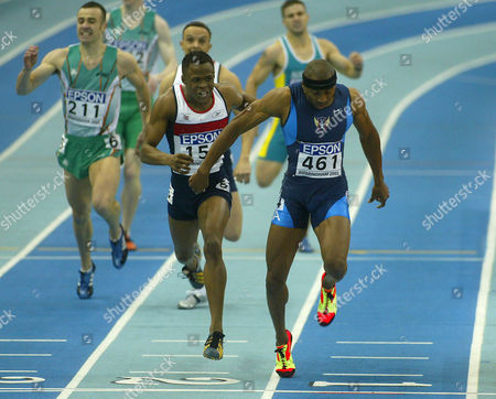 WASHINGTON CAINES Tyree Washington of the United States, right, gets to the line ahead of Britain's Daniel Caines to win the gold medal in the Men's 400 meters at the World Indoor Athletics Championships in Birmingham, England, . Caines took the silver