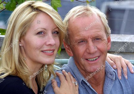 """Paul Hogan with his co-star wife Linda Kozlowski pose for the media on the terrace of their penthouse suite in a top London hotel . The couple are in London to promote their new film """"Crocodile Dundee in L.A"""