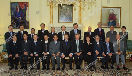 Britain's Prime Minister Tony Blair, sixth from left sitting, is photographed with members of the Anglo-Chinese Forum at Downing Street London . They are from top left standing- Ding Wei, Lin Jintong, Wang Jiming, Xin Futan, Xie Anshan, Wu Chunhe, Martin Broughton, Sir Leonard Appleyard, Richard Lambert, David Brewer and Katie Lee. Seated from left- Mei Zhaorong, Quges Ping, Chen Yuan, Xu Guanhua, Song Jian, Tony Blair, Lord Heseltine, Baroness Kennedy. Lord Puttnam, Sir Martin Jacomb and Sir Crispin Tickell