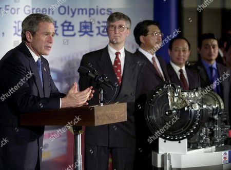 SHUSEN President Bush, left, speaks during a Beijing news conference touting natural gas bus engines made by Cummins, a U.S. engine company with a manufacturing division in Beijing, part of a strategy to clean the air here for the 2008 Olympics, . Businessmen include, from left in background: Tim Stratford, GM vice chairman in China, Steven Chew, GM Allison which makes transmissions, Zheng Shusen, president of Beijing Public Transportation Corporation and Xin Li, automotive director for Cummins
