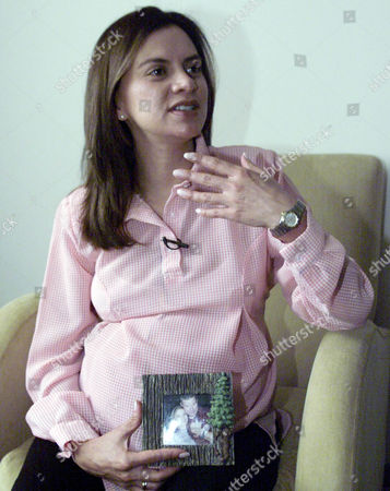 """Stock Photo of MEDINA Patricia Medina, the girlfriend of hostage Keith Stansell, speaks during an interview with Associated Press in Bogota, Colombia, . The single-engine Cessna carrying Stansell, Marc Gonsalves, Tom Howes, Tom Janis, U.S. Defense Department contractors and Colombian Army Sgt. Luis Alcides Cruz developed engine trouble and crash-landed on Feb. 13 in southern Colombia, near where rebel squad commanders were holding a meeting. The rebels of the Revolutionary Armed Forces of Colombia, FARC, pounced on the crash site, executed Janis and Cruz and took the other three away as """"prisoners of war."""" Medina, is eight months pregnant with their twin sons"""