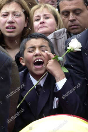 Stock Picture of DANIELS SENATOR'S SON: Hernando Rodriguez Daniels, 10, son of slain Colombian senator Martha Catalina Daniels cries during his mother's funeral in Bogota, Colombia on . Daniels and two companions were trying to negotiate the release of rebel hostages when they were shot in the head and killed, apparently by the rebels of the Revolutionary Armed Forces of Colombia, or FARC. The bodies of the senator, her driver, Carlos Lozano, and Ana Maria Medina were found Saturday in a deep ravine outside Zipacon, 35 miles north of Bogota