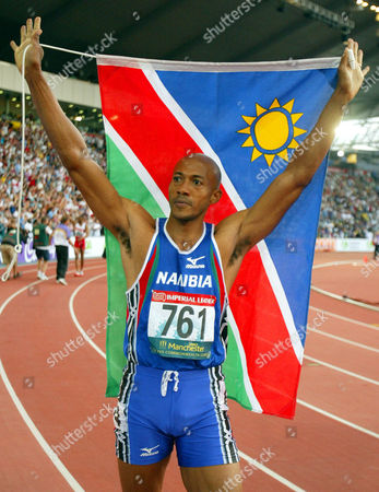 FREDERICKS Namibia's Frankie Fredericks celebrates during his victory lap after winning the gold medal in the Men's 200 meters at the Commonwealth Games in Manchester, England . Fredericks, a two-time Olympic silver medalist and the defending Commonwealth champion, clocked 20.06 seconds