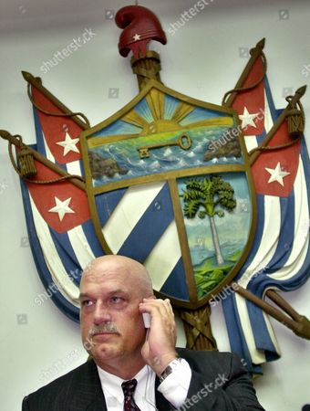 VENTURA Minnesota Gov. Jesse Ventura prepares to deliver a speech at the University of Havana while sitting in front of the Cuban coat of arms in Havana, Cuba on