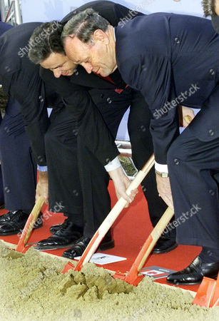 CHRETIEN WOWEREIT Canadian Prime Minister Jean Chretien, right, and Berlin Mayor Klaus Wowereit, left, use their spades during the groundbreaking ceremony for Canada's new Embassy building in the German capital Berlin on Monday, Feb.18, 2002
