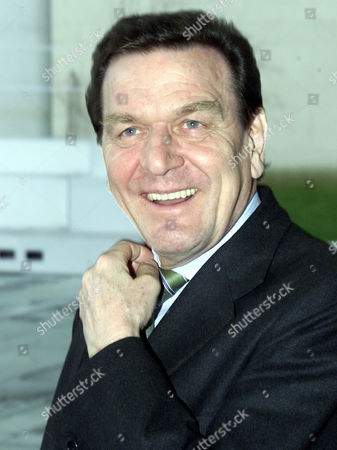Stock Picture of SCHROEDER German Chancellor Gerhard Schroeder smiles as he waits for the arrival of Jean-Claude Juncker, Premier of Luxembourg, at the Berlin Chancellery on