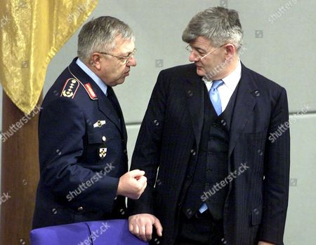 KUJAT FISCHER German Foreign Minister Joschka Fischer, right, listens to the chief of staff of German armed forces, General Harald Kujat, left, during the special debate in Berlin Parliament . The parliament will decide to send German armed forces for the UN peace keeping mission to Afghanistan