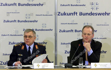 """SCHARPING KUJAT German Defense Minister Rudolf Scharping, right, and Inspector General of Staff Harald Kujat, left, are seen during a meeting with female soldiers in the defense ministry in Berlin . Scharping invited some 50 female sodiers to an information meeting after one year of duty in the German army. The words in the background reads """"Future Bundeswehr (German Army"""