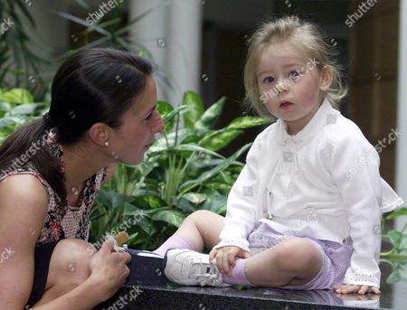 Michelle Engel, left, is talking to her 2 year old daughter Julia, right, at the German Heart Center in Munich on . Julia got cardiac surgery 2 years ago, when she was 12 weeks old, after doctors recognized an inborn cardiac defect. On June 6 and 7, 2002, six babies will get cardiac surgery at the Heart Center in Munich. These surgeries will be shown live to an audience of heart surgeons