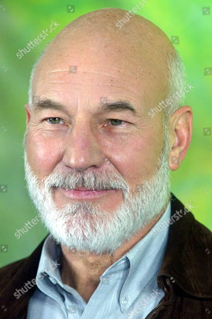 """STEWART British actor Patric Stewart poses during a photo-call for his new film,"""" Nemesis"""", the 10th part of the """"Star Trek"""" movie series in Berlin . Stewart plays """" Captain Jean-Luc Picard in the movie"""