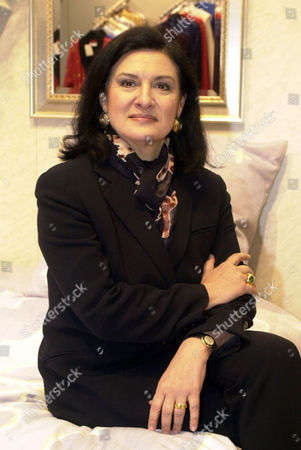 """PALOMA PICASSO French designer Paloma Picasso, daughter of famous painter Pablo Picasso sits on a bed at the Home Fashion Fair """"Heimtextil"""" in Frankfurt, Germany"""