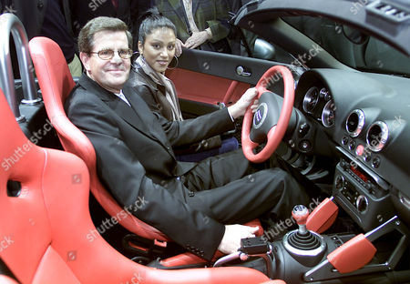 "Bernd Gottschalk, president of the German car industry association and German singer Sabrina Setlur vistit the Audi company stand and have a seat in a ""TT-Roadster"" after the opening ceremony of the ""Motor Show""-fair in the western German city of Essen on . A couple hundred exhibitors will present their products from Nov. 30 until Dec. 9, 2001 and expect more than 400.000 visitors"