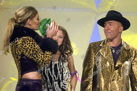 Connor LOU BEGA German singer Sarah Connor, left, kisses the trophy after she was awarded with this year'ss Comet media prize for music artists and bands in Cologne, western Germany, Friday night, Aug. 17. 2001. She was awarded in the category National Newcomer. The Comet was presented by German TV stations VIVA and ZDF. Right looks singer Lou Bega, who handed over the trophy