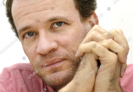 MARTEL This year's Booker Price winner Canadian author Yann Martel holds the hands on his face during a interview in Berlin