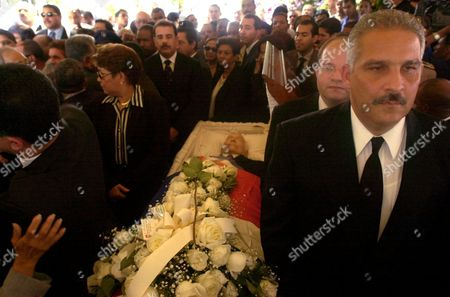 BOSCH Former Dominican Vice President Jaime David Fernandez, right, joins other mourners around the open casket of former Dominican President Juan Bosch during a vigil in his honor on in Santo Domingo, Dominican Republic. Bosch, a powerful figure in Dominican politics whose influence stretched across half a century despite serving only seven months as president, died Thursday. He was 92. Bosch was the first president elected after dictator Rafael Trujillo was assassinated in 1961