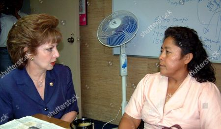 EL SALVADOR MADRE Beatrice de Carrillo, head of Salvador's human rights office speaks with Marina del Carmen Flores at the human rights office in San Salvador, El Salvador . Flores, mother of Luis Martinez Flores accused of a minor role in the Sept. 11 terror attacks in the United States asked the government's human rights office to help her communicate with her son. According to an FBI statement unsealed Monday, the 28-year-old Martinez was charged Friday with falsely certifying that Hani Hanjour and Khalid Almihdhar lived at his Falls Church, Virginia, address