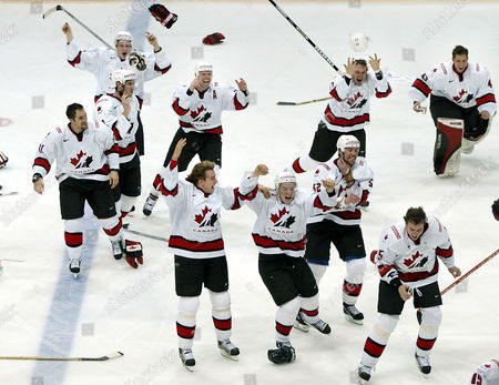 Canadian hockey players run towards player Anson Carter, not seen, after the referees decided to give his 3-2 goal in overtime during the final ice hockey match between Canada and Sweden at the Ice Hockey World Championship in Helsinki, Finland, . Canada became the new World Champions