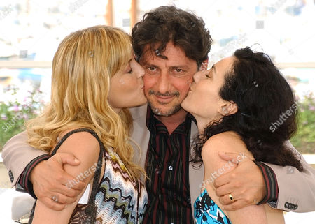 """CASTELLITTO LUSTIG CONTI Italian actress Chiara Conti, left, Italian actor Sergio Castellitto, center, and Itilian-Argentinian actress Jacqueline Lustig, pose before the screening of their film """"The Religion Hour"""", which is in competition at the 55th International Film Festival in Cannes, south eastern France"""