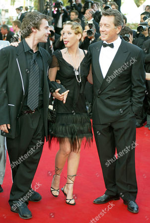 """SAGNIER STEVENIN GIRAUDEAU French actors Ludivine Sagnier, center, Robinson Stevenin, left, and Bernard Giraudeau, smile as they arrive for the screening of their film""""La Petite Lili,"""" in competition, directed by French Claude Miller, at the 56th Film Festival in Cannes, France"""