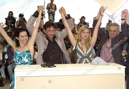 """BELLOCCHIO Left to right, Italian actress Chiara Conti, left, Italian actor Sergio Castellitto, Itilian-Argentinian actress Jacqueline Lustig, and Italian director Marco Bellocchio pose before the screening of their film """"The Religion Hour"""", which is in competition at the 55th International Film Festival in Cannes, south eastern France"""