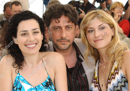 """CASTELLITTO LUSTIG CONTI Italian actress Chiara Conti, left, Italian actor Sergio Castellitto, center,and Itilian-Argentinian actress Jacqueline Lustig, pose before the screening of their film """"The Religion Hour"""", which is in competition at the 55th International Film Festival in Cannes, south eastern France"""