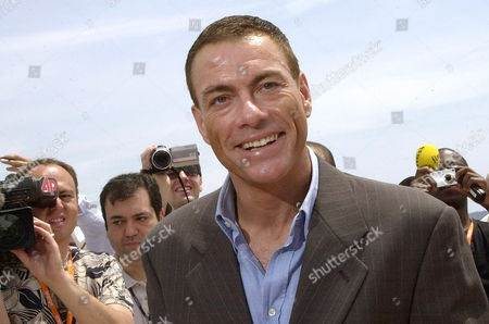 "Belgian actor Jean-Claude Van Damme, poses during a photocall to promote his new film""After Death"" directed by Hong Kong born Ringo Lam on the sideline of the 56th Film Festival in Cannes, France"