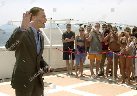 "Belgian actor Jean-Claude Van Damme, waves to festival-goers as he poses during a photocall to promote his new film""After Death"" directed by Hong Kong born Ringo Lam, on the sideline of the 56th Film Festival in Cannes, France"