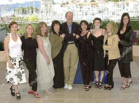 "From left Canadian actors Isabelle Blais, Mitsou Gelinas Johanne Tremblay, Dorothee Berryman, Canadian director Denys Arcand, Louise Potral, Marie-Jose Croze, Dominique Michel, Marina Hands, pose for their film'Les Invasions Barbares,"" (The Barbarian Invasions) in competition, during a photo call at the 56th Film Festival in Cannes, France"