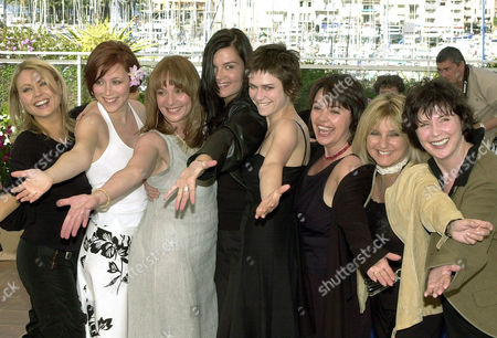 "Stock Photo of From left Canadian actors Mitsou Gelinas, Isabelle Blais, Johanne Tremblay, Marina Hands, Marie-Jose Croze, Louise Portal, Monique Michel, and Dorothee Berryman pose for their film'Les Invasions Barbares,"" (The Barbarian Invasions) in competition, directed by Candian Denys Arcand, during a photo call at the 56 Film Festival in Cannes, France"