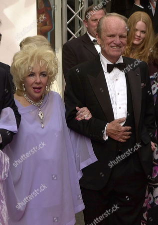 "TAYLOR STEVENS American actress Elizabeth Taylor, left, and Geroge Stevens Jr., right, smile as they arrive for the screening of the U.S. DVD debut of the larger-than-life classic""Giant"" produced and directed by George Stevens Sr., at the 56th Film Festival in Cannes, France, Wednesday, May 21,2003. Based on Edna Ferber's best-selling family saga about a Texas family of ranchers and oilmen, Giant stars Taylor, James Dean and Rock Hudson and was released in 1956"