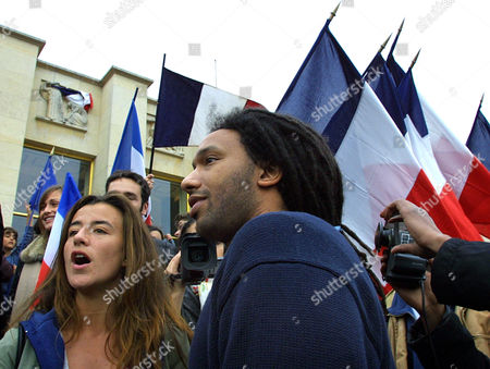 BORHINGER DOC GYNECO Actress Romane Borhinger, left, and rap singer Doc Gyneco stand next to French flags during a rally against Jean-Marie Le Pen, in Paris. Conservative candidate Jacques Chirac will face far-right leader Jean-Marie Le Pen in the second round of the presidential election on May 5