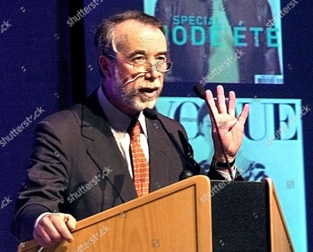 DE SOLE Gucci Group chief executive Domenico de Sole gestures during a press conference of its owner French retailer group Pinault Printemps Redoute (PPR), in Paris in this March 7, 2002 photo. PPR and Gucci Group announced, that de Sole and creative director Tom Ford will both leave the company next year