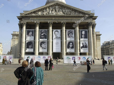 Stock Picture of Giant portraits of French famous women are displayed in front of the Pantheon, in celebrations of the international women's day in Paris, . Clockwise from top left, writer Charlotte Delbo, Solitude (unknown), scientist Marie Curie, woman revolutionaries in 1791 Olympe de Gouges, writer Simone de Beauvoir, anarchist Louise Michel, writer George Sand, first freemason woman Maria Deraismes, and writer Colette . The poster, center, reads : to the famous women of the grateful fatherland