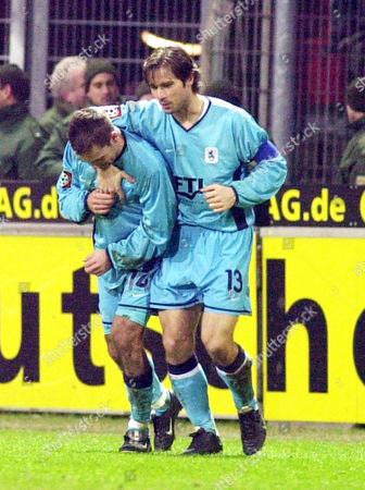 WIESINGER CERNY Michael Wiesinger, left, and Harald Cerny of TSV 1860 Munich celebrate after the third goal against 1.FC Kaiserslautern, during the first division soccer match Wednesday, Dec 19, 2001 in the Kaiserslautern, western Germany, Fritz-Walter-Stadium. Muenchen wins 3-1