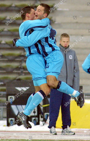 MAX WIESINGER Munich's Martin Max, left, celebrates with teammate Michael Wiesinger after scoring the 1-1 during the German first soccer league match TSV 1860 Munich versus Borussia Moenchengladbach at the Olympic stadium in Munich, southern Germany on