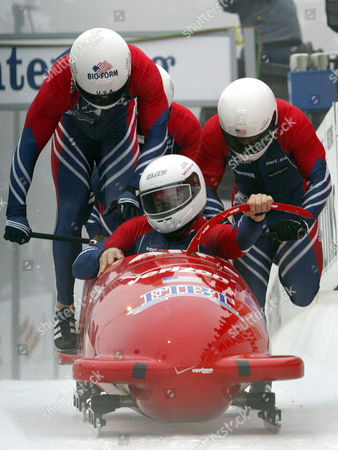 """HAYS START U.S. bob pilot Todd Hays, front, and his team with Randy Jones, Paul Jovanovic and brakesman Garrett Hines push their four-men bob """"USA 1"""" at the start on the bobsleigh track in Winterberg, western Germany, on . Hays placed third behind winning team """"Germany 1"""" and runner-up """"Germany 2"""