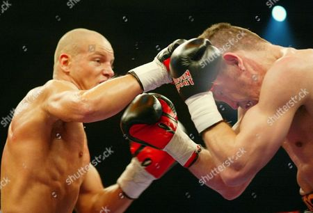 Stock Photo of ULRICH ROCCHIGIANI Graciano Rocchigiani, right, is hit by a punch of Thomas Ulrich during the WBC half-heavyweight fight of the two German boxers in the Hanns-Martin-Schleyer indoor arena in Stuttgart, southwestern Germany, late . Ulrich won the fight by points in 12 rounds