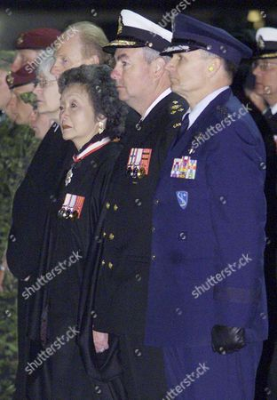 BERNARD-MEUNIER U.S. Gen. Gregory S. Martin, Canadian Vice-Admiral James King, Canadian Gov. Gen. Adrienne Clarkson, her husband John Ralston-Saul and Canadian Ambassador to Germany Marie Bernard-Meunier, from right to left, watch the arrival of the victims of a friendly fire training accident in a C-17 Globemaster plane after its arrival from Afghanistan at Ramstein air base in southwestern Germany, early . Four Canadian soldiers were killed and eight injured by a U.S. bomb in Wednesday's friendly fire training accident
