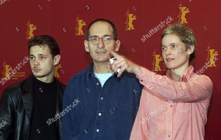 "WANNEK GRAF EICHHORN German actor Antonio Wannek, director Dominik Graf, and actress Karoline Eichhorn, from left, pose during a photo call before a press conference about their new film ""Der Felsen (A Map of the Heart)"" running in the competition at the 52nd Berlinale Film Festival in Berlin on"