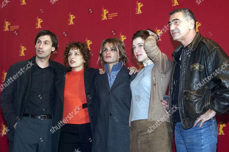 "Stock Image of SCHAUSPIELER Italian actors Fabrizio Gifuni, Valeria Bruni Tedeschi, director Nina di Majo, actress Valeria Golino and Greek actor Yorgo Voyagis, from left, pose during a photo call before a press conference about their new film ""L'Inverno (Winter)"" running out of competition at the 52nd Berlinale Film Festival in Berlin on"