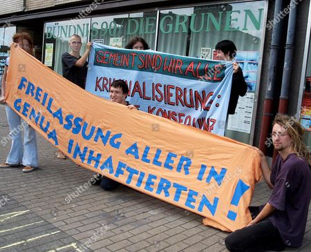 "About 30 anti-globalisation protestors occupied the constituency office of Germany's deputy foreign minister Ludger Volmer on in Gelsenkirchen, Germany. Banner reads ""Release all in Genoa imprisoned"