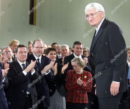 HABERMAS SCHROEDER German philosopher Juergen Habermas, right, stands on the podium following his speech while, from left, German Chancellor Gerhard Schroeder, Jan Philipp Reemtsma, who delivered the laudatory speech, Reemtsma's wife Ann Katrin Scheerer, and the President of the German Constitutional Court Jutta Limbach applaud. Habermas was awarded with the renowned Peace Prize of the German Booktraders' Association in Frankfurt, Germany