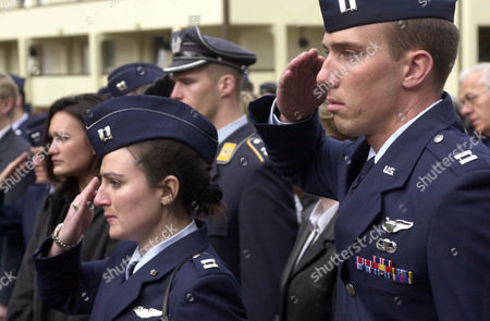 CANCEL U.S. Air Force Cpt. Corinne Cancel, left, a C-21 pilot and another unidentified U.S. Air Force Captain, right, salute among mourners for the deceased Cpt. Luke A. Johnson at the 52nd Fighter Wing, Spangdahlem Air Base, western Germany, on . Johnson, a U.S. Air Force F-16 fighter pilot with the 23rd Fighter Squadron, died March 20, 2002, in a crash of his plane while being on routine night maneuvers. Center is an unidentified German Air Force member saluting