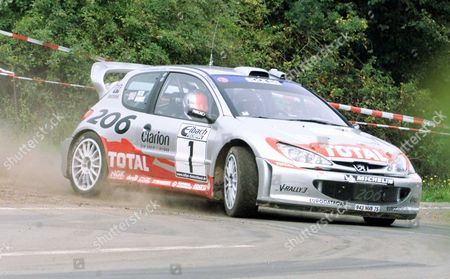 GERMAN RALLY BURNS Britain's Richard Burns steers his Peugeot 206 around a curve during stage 21 at the German Rally near St. Wendel, southwestern Germany, . Burns was in 2nd place before the final stage behind Frenchman Sebastian Loeb in his Citroen in the first ever World Rally Championship event held in Germany